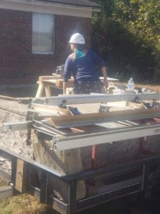 BC Volunteer cutting soffit 3