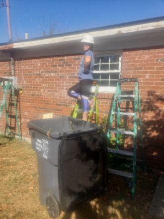 BC volunteer repairing soffit