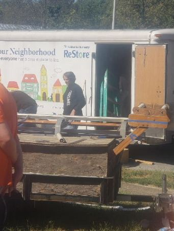 Home Repair volunteer and Habitat Trailer